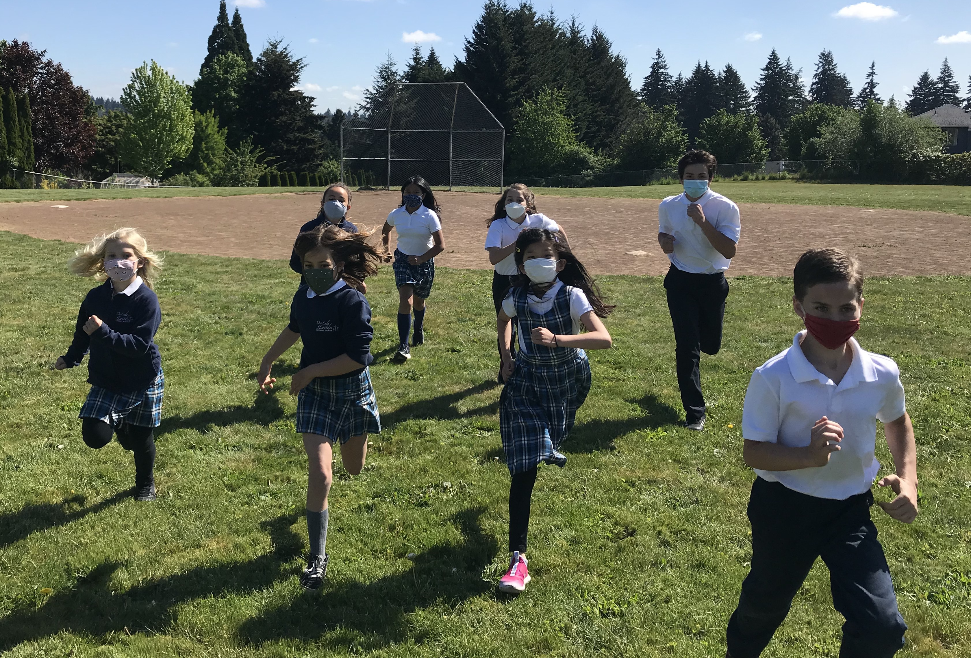Our Lady of Lourdes Catholic School Students Running Through Field COVID Safe